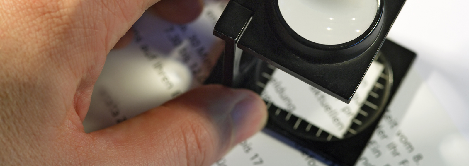 Shallow depth of field image of a printer using a loupe to check text